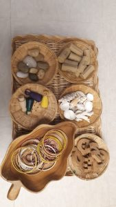 A group of different baskets with loose parts.
